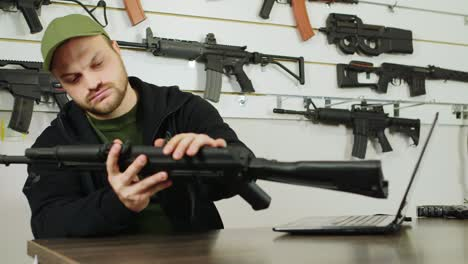 Man-behind-a-counter-in-an-arms-store-1