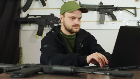 Man-behind-a-counter-in-an-arms-store-3
