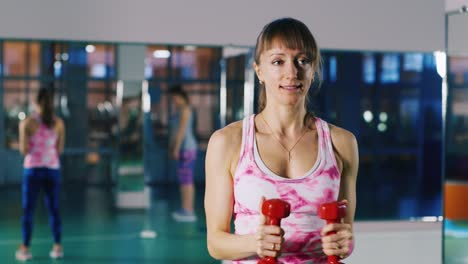 Woman-does-an-exercise-with-dumbbells