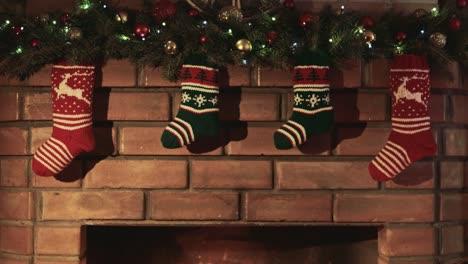 Christmas-gift-socks-hang-over-the-fireplace-where-the-fire-burns-2