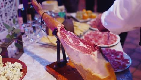 Man-cuts-jamon-into-thin-slices-1