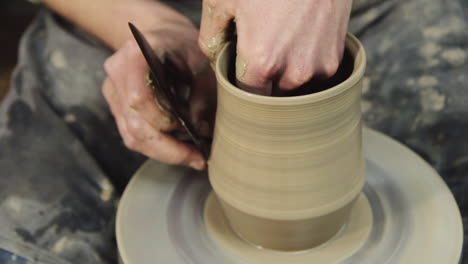 The-hands-of-a-potter-make-a-jug-on-a-potter-s-wheel-2