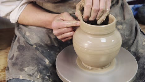 The-hands-of-a-potter-make-a-jug-on-a-potter-s-wheel-3