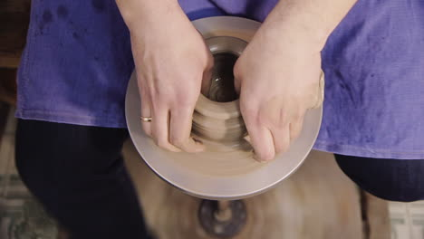 The-hands-of-a-potter-make-a-jug-on-a-potter-s-wheel-6