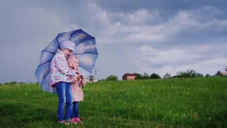 Children-hide-under-an-umbrella-from-the-rain
