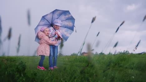 Children-hide-under-an-umbrella-from-the-rain-1