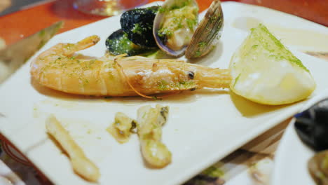 A-tourist-eats-exquisite-seafood-at-a-fish-market-in-Barcelona