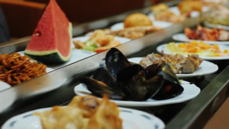 Seafood-plates-move-on-conveyor-belt-at-All-Inclusive-Restaurant-1