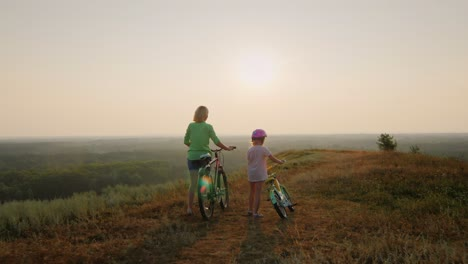 A-woman-and-a-child-ride-bicycles-3