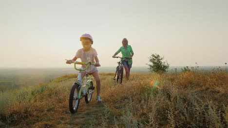 A-woman-with-a-child-rides-a-bicycle-in-nature-1