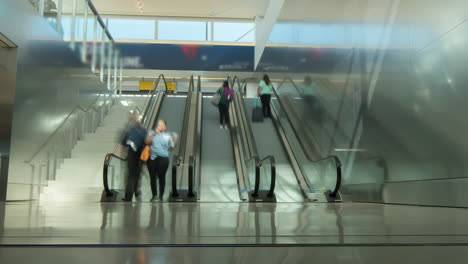 People-on-an-airport-escalator
