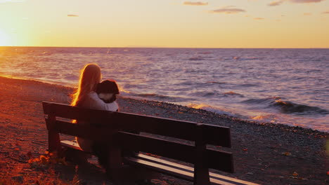 A-woman-rests-with-a-dog-on-a-bench-1