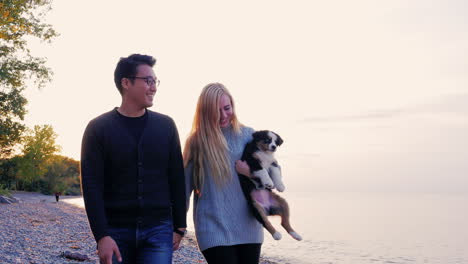 Young-couple-walking-the-dog