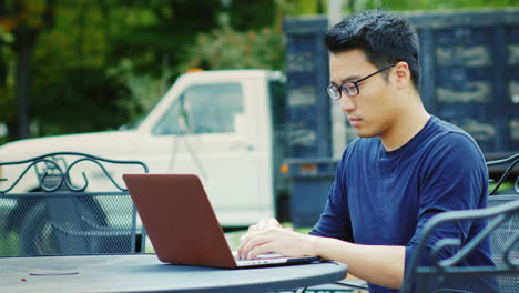 A-Young-Asian-Man-Works-With-A-Laptop-1