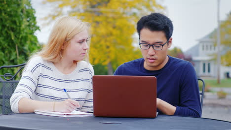 Students-Work-With-A-Laptop-At-The-Table-Of-A-Summer-Cafe-1