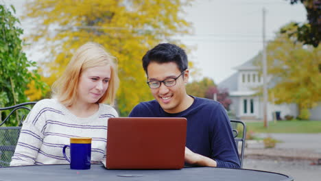 Students-Work-With-A-Laptop-At-The-Table-Of-A-Summer-Cafe-2