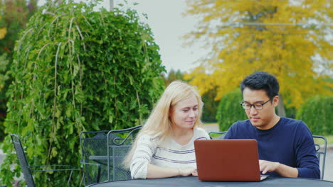 Students-Work-With-A-Laptop-At-The-Table-Of-A-Summer-Cafe-7