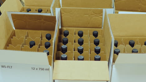 Packaging-Bottle-With-Alcohol-In-Cardboard-Box