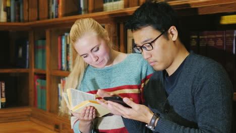Friends-Of-Students-Together-Look-At-The-Book-In-The-Library-1