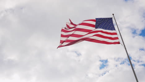 Large-Us-Flag-On-A-Background-Of-Gray-Sky-Beautifully-Illuminated-By-The-Sun-1