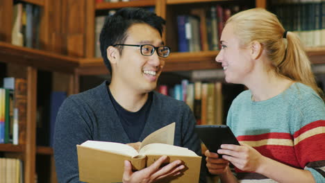 Smiling-Korean-Man-Talking-To-A-Woman-In-The-Library