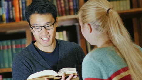 Smiling-Korean-Man-Talking-To-A-Woman-In-The-Library-2
