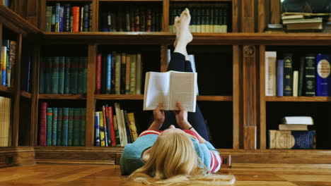 Young-Woman-Lying-Down-Reading-A-Book-1