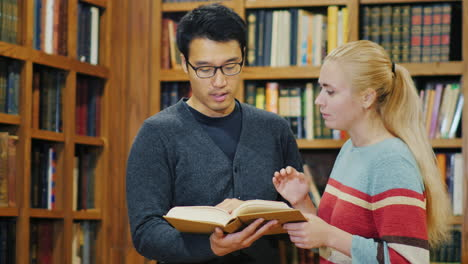 Smiling-Korean-Man-Talking-To-A-Woman-In-The-Library-4
