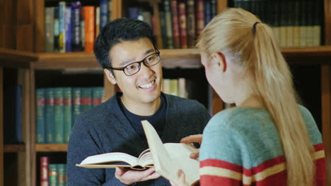 Smiling-Korean-Man-Talking-To-A-Woman-In-The-Library-5