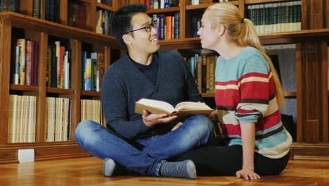 Smiling-Korean-Man-Talking-To-A-Woman-In-The-Library-6