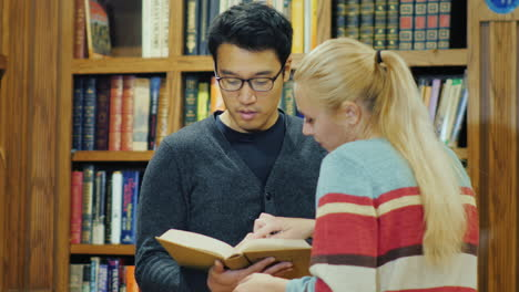 Smiling-Korean-Man-Talking-To-A-Woman-In-The-Library-7