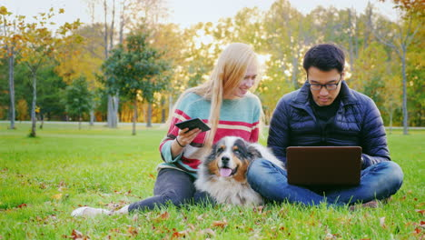 Friends-Relaxing-On-The-Lawn-In-The-Park