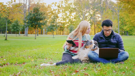 Friends-Relaxing-On-The-Lawn-In-The-Park-1