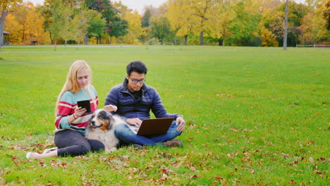 Friends-Relaxing-On-The-Lawn-In-The-Park-2