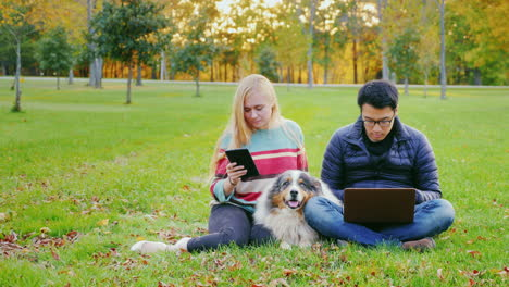 Friends-Relaxing-On-The-Lawn-In-The-Park-3