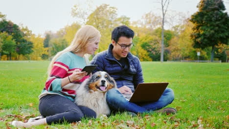 Friends-Relaxing-On-The-Lawn-In-The-Park-4