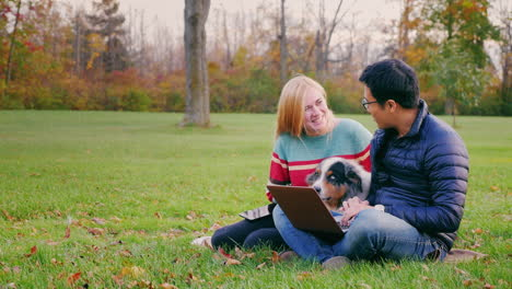 Friends-Relaxing-On-The-Lawn-In-The-Park-6