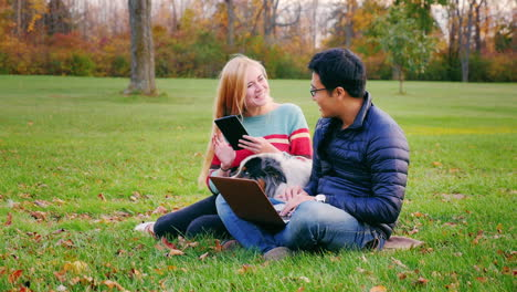 Friends-Relaxing-On-The-Lawn-In-The-Park-7