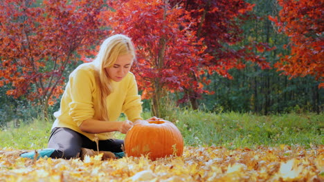 Young-Woman-Carves-A-Pumpkin