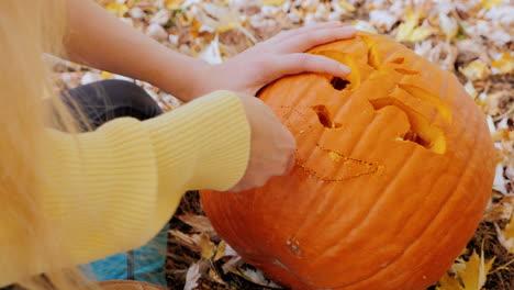 Young-Woman-Carves-A-Pumpkin-1