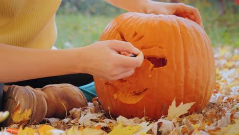 Young-Woman-Carves-A-Pumpkin-2