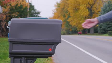 A-Man-Puts-Post-In-A-Mailbox-1