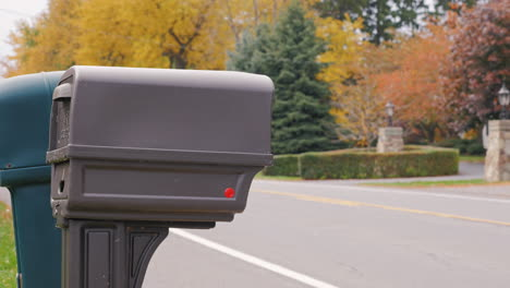 Us-Mail-Delivery-Where-A-Man-Picks-Up-Mail-From-The-Mailbox-Beside-The-Road