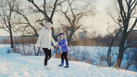 A-Woman-With-A-Child-Rejoices-In-Winter-And-Snow-1