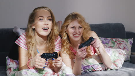 Two-Young-Female-Friends-Playing-On-The-Computer-Console-1