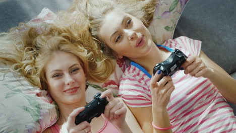 Two-Young-Female-Friends-Playing-On-The-Computer-Console-2