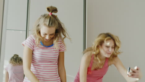 Two-Young-Girlfriends-Teens-Learn-To-Perform-Funny-Dance