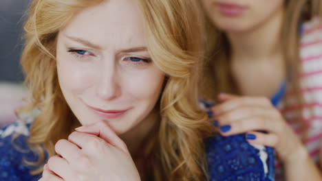 Young-Woman-Comforts-And-Supports-His-Girlfriend-Who-Is-Upset-And-Crying-3