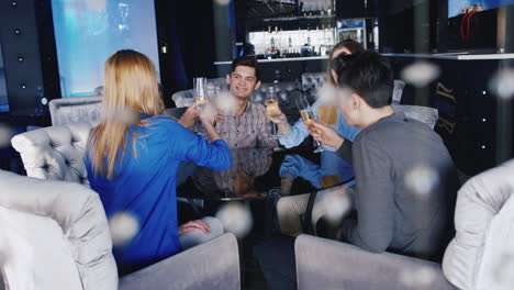 Young-People-Relax-At-A-Table-In-A-Cozy-Restaurant-While-They-Talk-And-Have-A-Good-Time-1