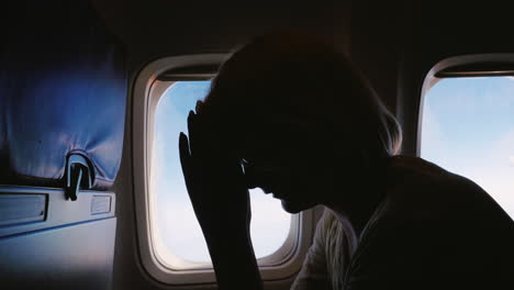 Woman-Experiences-Anxiety-In-Flight